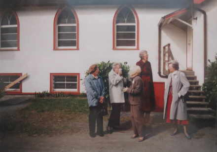 Congregation on side steps of the Church